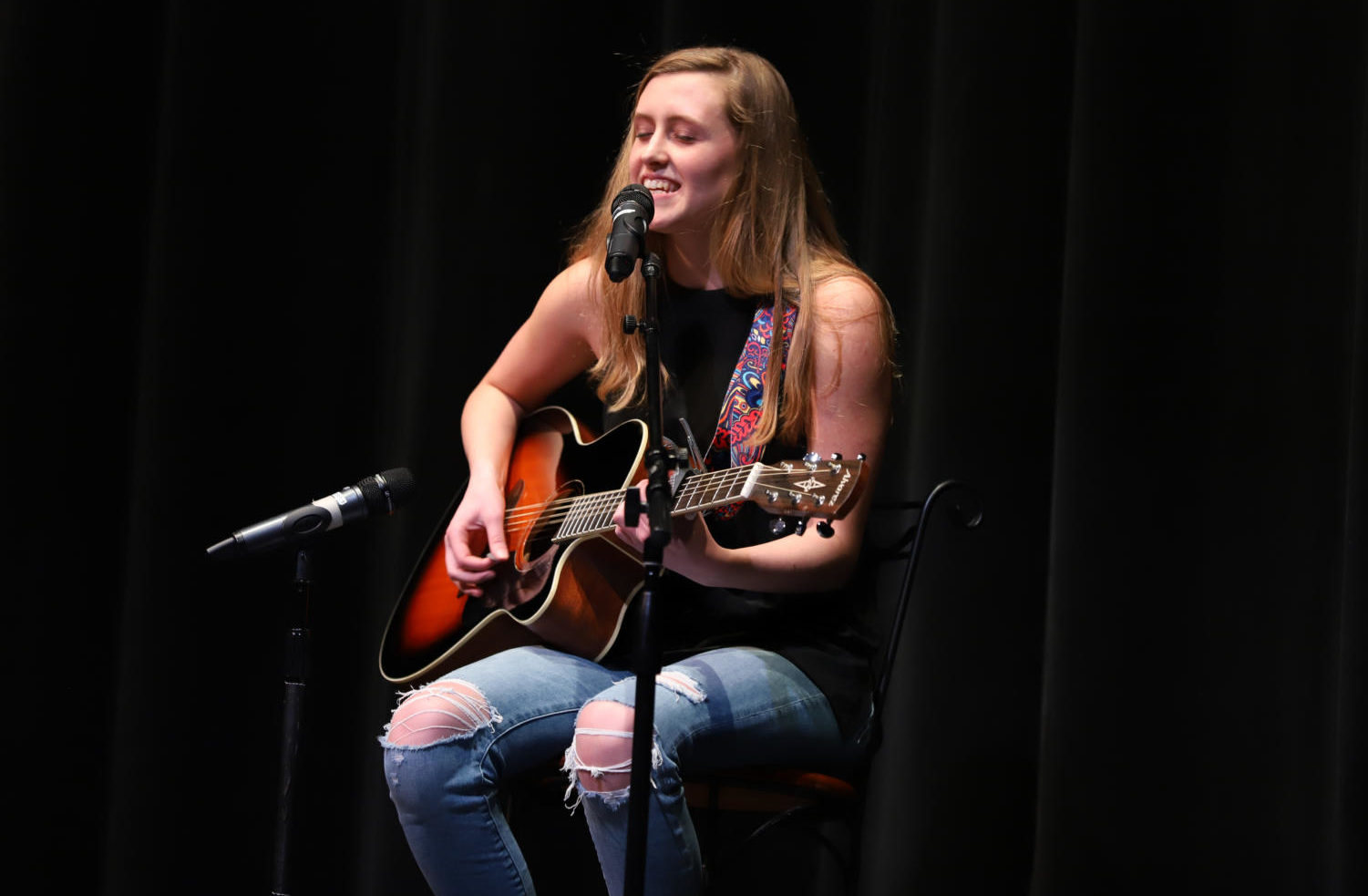 The winner of the second annual talent show, junior Dessa Outman, sings, plays and performs an original song.