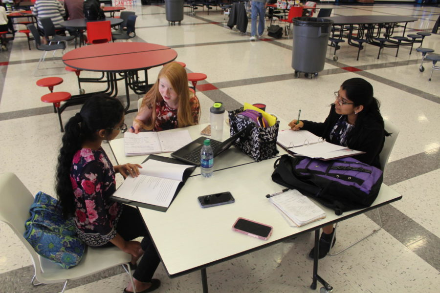 Mahathi Manikandan, (left) Maddie Sanderson, (middle) and Sanjana Anand, (right) prepare for their upcoming debate events.
