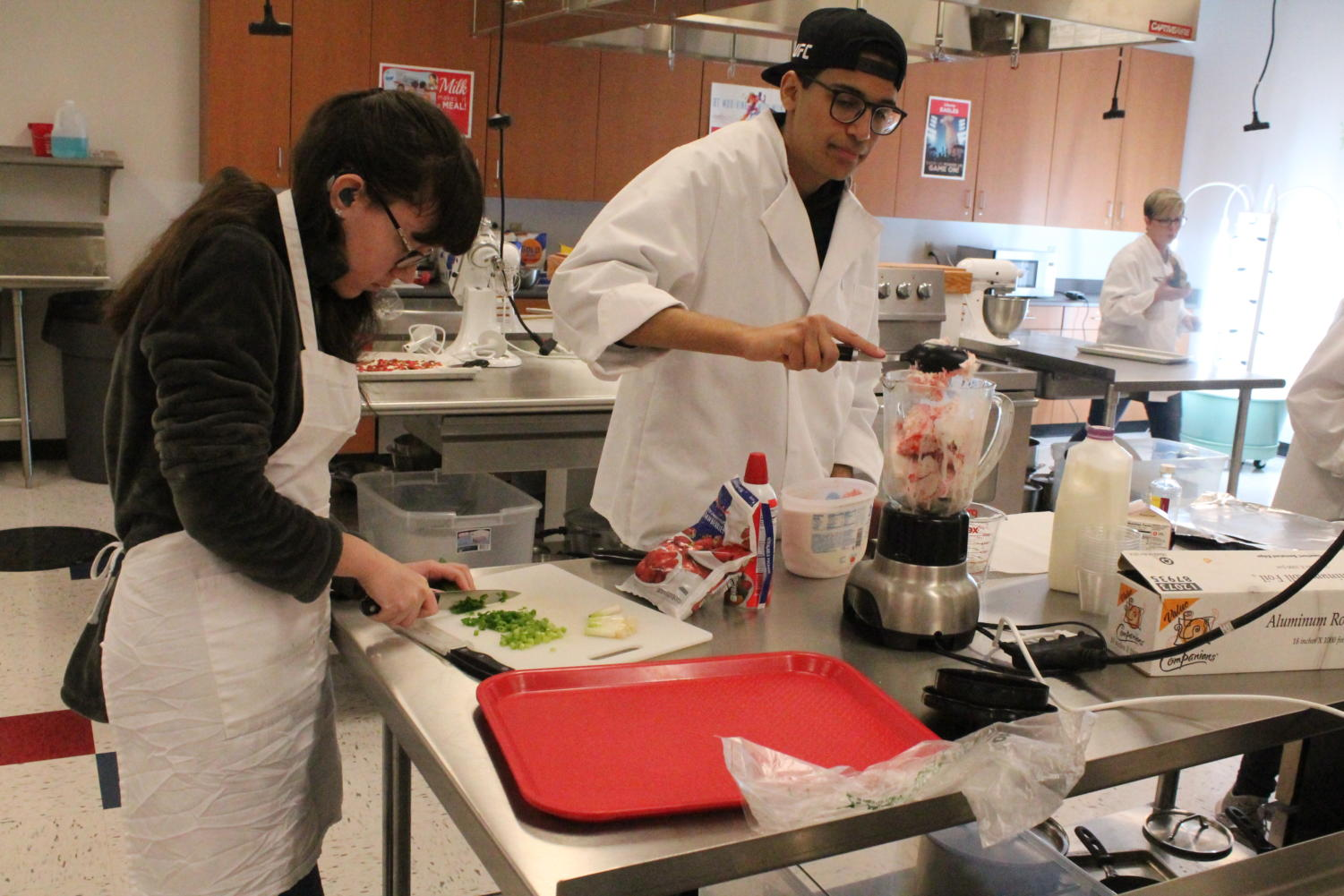 Students prepare meals for staff members on Valentine's Day.