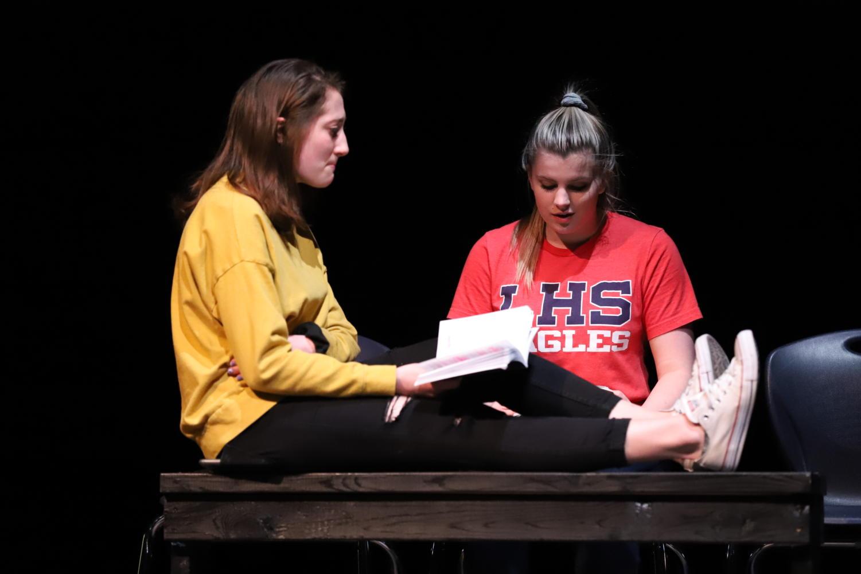 Juniors Julia Deters (left) and Emily Gann (right) rehearse a scene from Radium Girls.