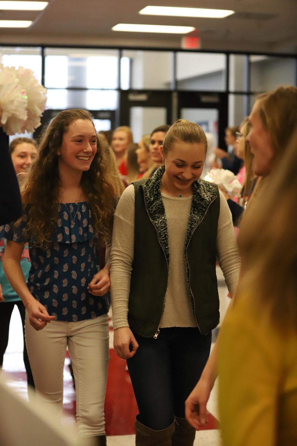 Swimmers and state qualifiers sophomore Caroline Myers (left) and freshman Evan Worobec (right) join the state qualifiers who participated in the all-school clap out Thursday before the team left for state.