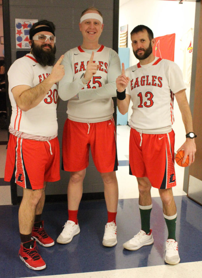 Mr. Cole (center) joins Mr. Schumacher (left) and Mr. Walterbach (right) on Tuesday's jersey day. Cole won the title as the most spirited teacher at the spirited week pep assembly.