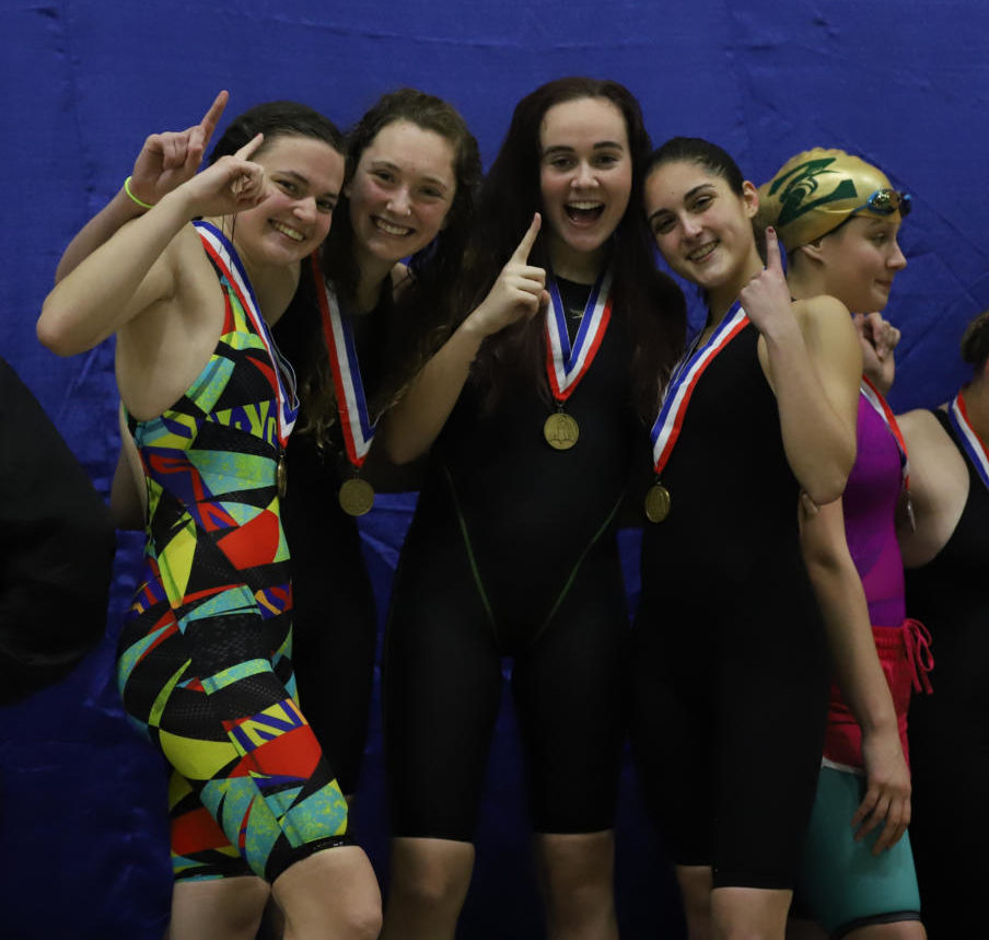 Marjori Russo (12), Caroline Myers (10), Anna Decker (10) and Hallie Anderson (11) pose after earning first place in the 200 medley relay.