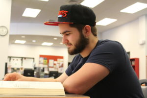 Junior Nash Gilbo studies for the SAT in the library.