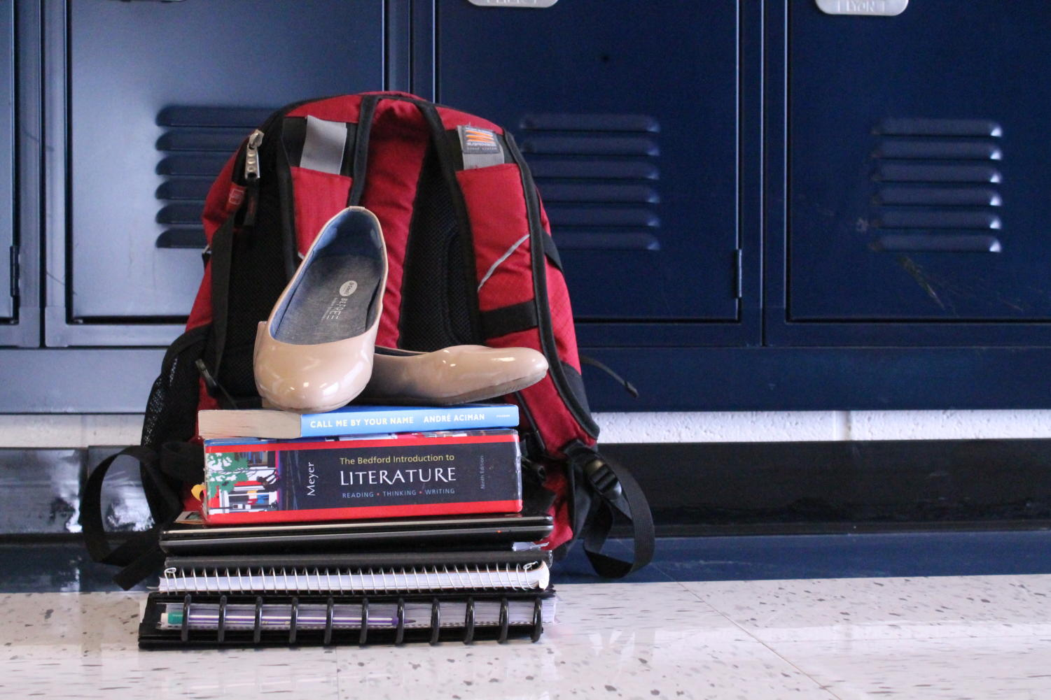Textbooks, a planner and a spare pair of shoes are just a few of the items I keep with me in my 22.6 lbs backpack.
