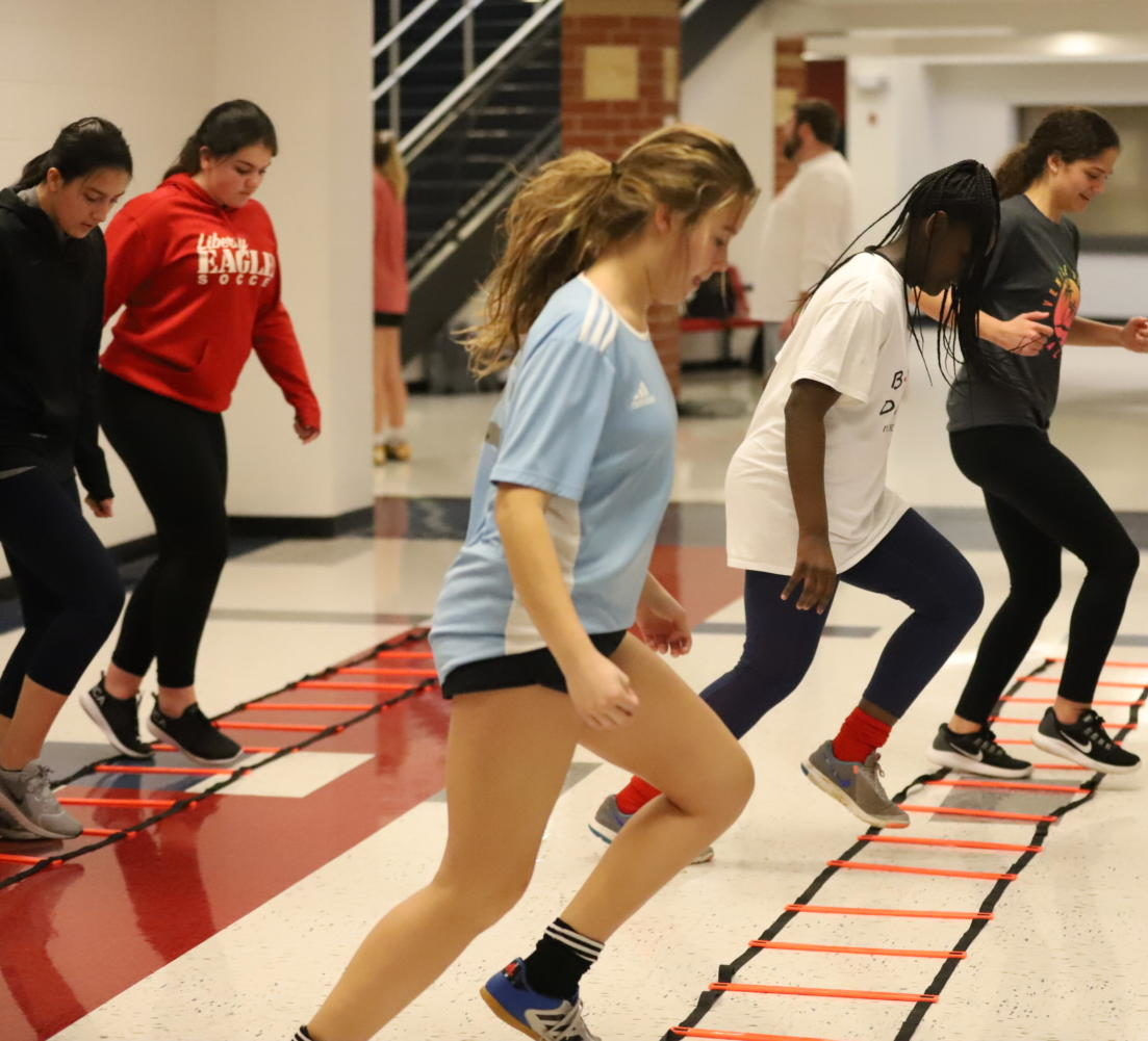 Soccer athletes get their footwork drills done inside. Cold weather has forced many practices to take place indoors.