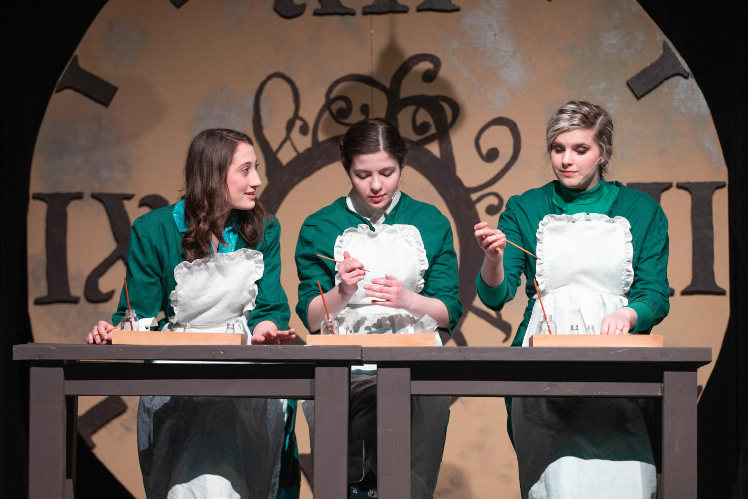 From left to right: Julia Deters, Michelle Yoder, and Emily Gann play women in the 1920's who painted dials for a radium company.