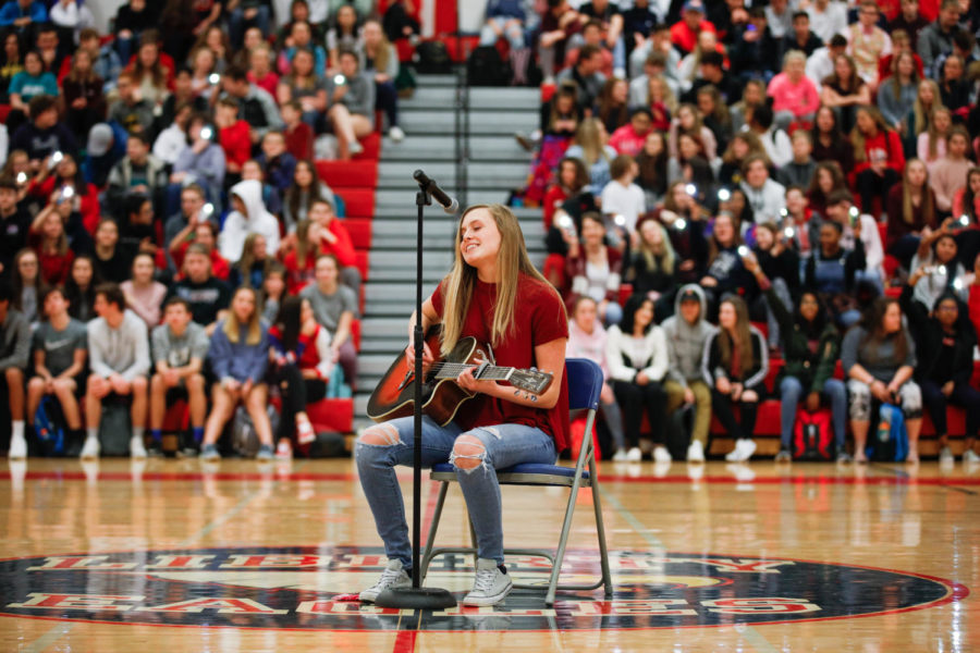 Talent+show+winner+Dessa+Outman+%2811%29+performs+her+original+song%2C+%22Don%27t+Let+Me+Go%22%2C+at+the+winter+pep+assembly.+