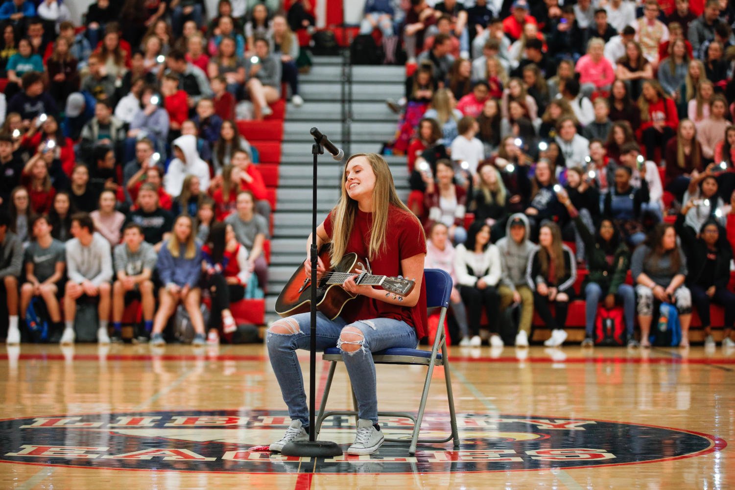 Talent show winner Dessa Outman (11) performs her original song,