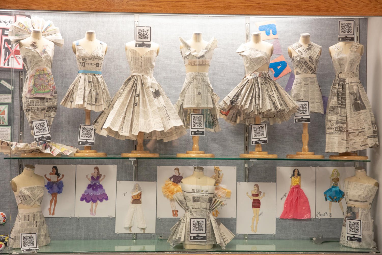 The dresses are on display in the 300 hallway for students and faculty to see.