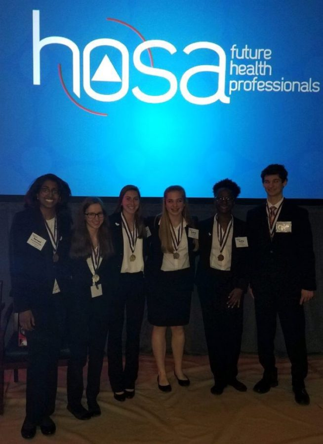 Liberty+HOSA+students+qualify+for+internationals+and+pose+for+a+quick+picture+at+the+conference.+