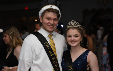 Seniors Hunter Perkins and Brittanie Tabers smile with their crowns after winning senior prom king and queen.