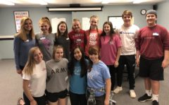 ASC Leaders Pack Food For Children In Community