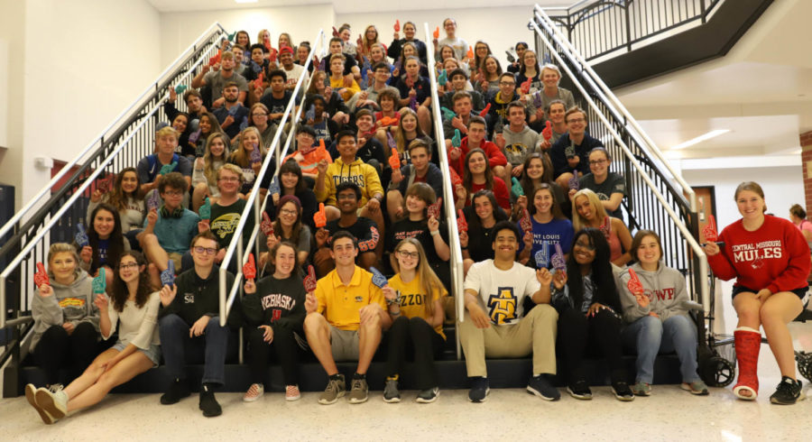 Many+seniors+proudly+wear+their+college+shirt+for++National+Decision+Day.+