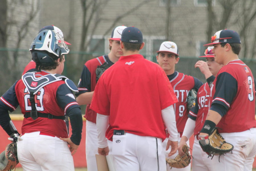 Coach+Clements+talks+to+the+team+at+the+mound+in+a+game+against+Hannibal.+The+Eagles+won+13-3+on+March+19.