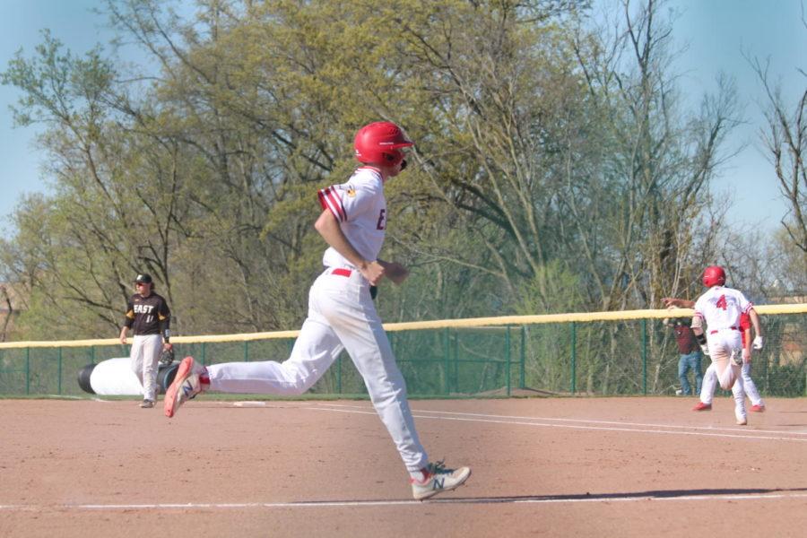 Chase Hoeber runs home after a Brady Voss hit.