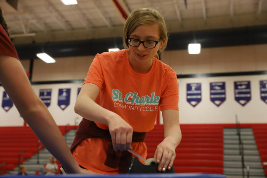 Senior Marissa Pukala-Whitaker sets up a booth. She was in charge of planning the De-Stress Event.