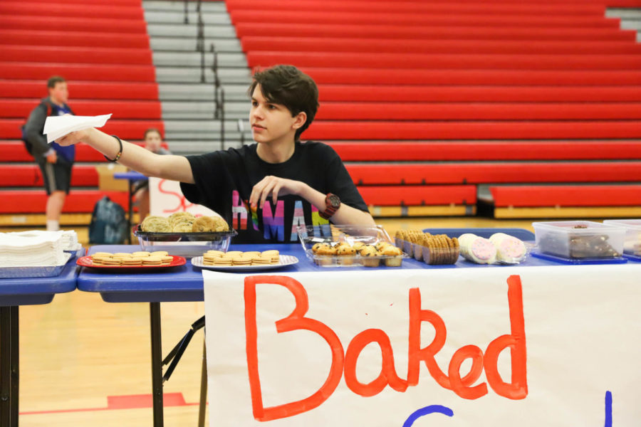 Freshmen Jackson Martin ran the Baked Goods booth. Come Together leaders baked and purchased cookies to give out for free at the event.