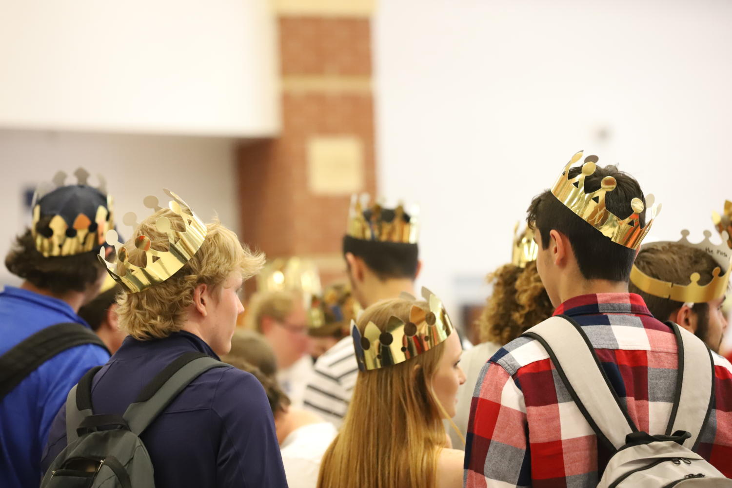 Seniors don their crowns and wait to make their entrance at the assembly.