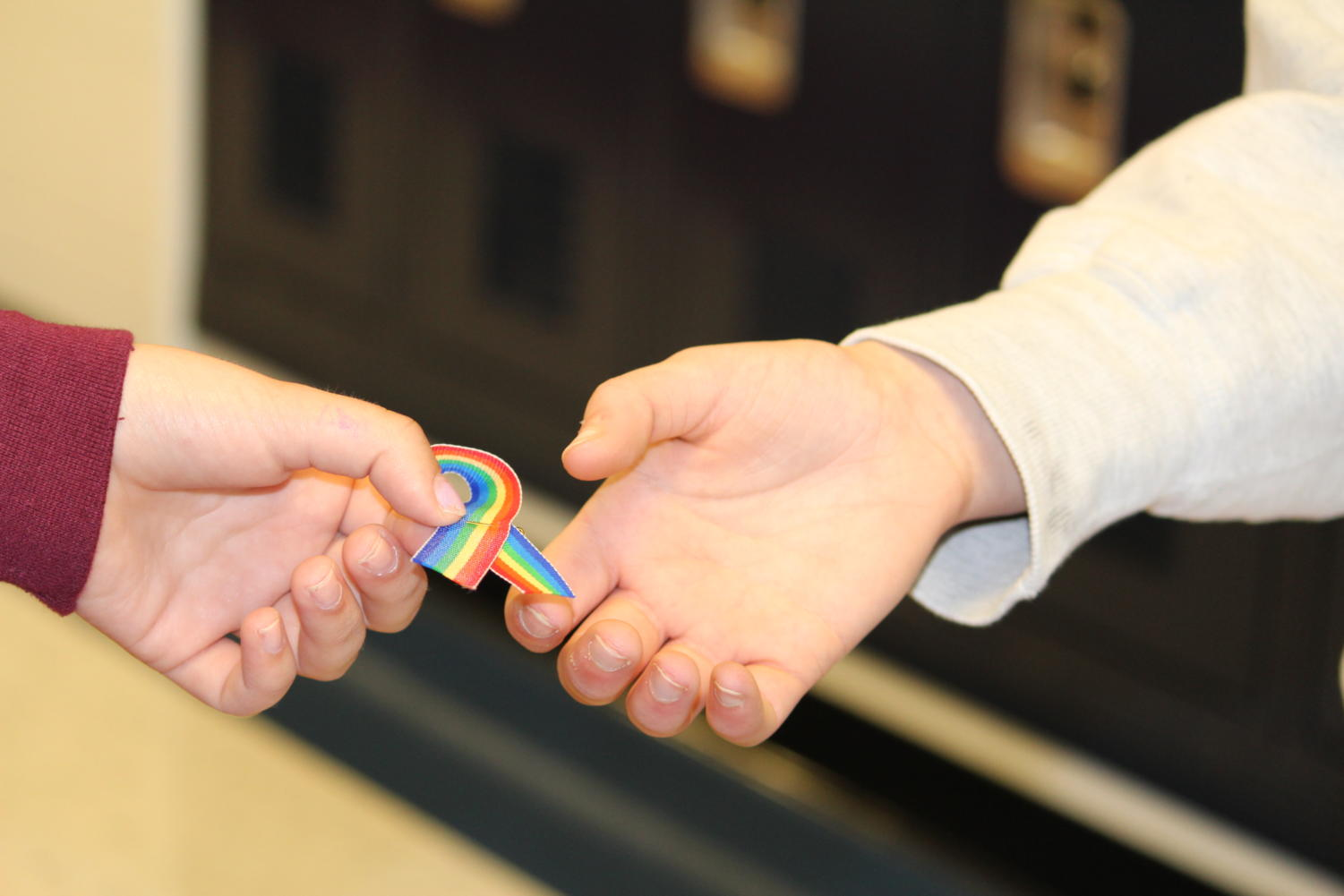 GSA officers made rainbow pins out of ribbon so that those participating could show their pride.