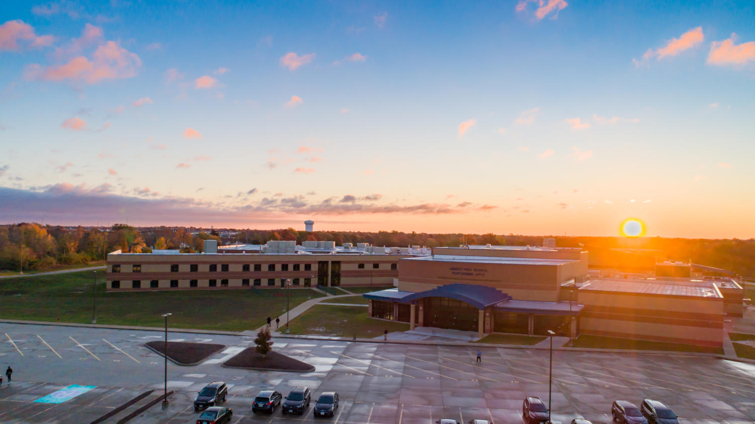 The sun is rising over Liberty, creating a beautiful scenery.