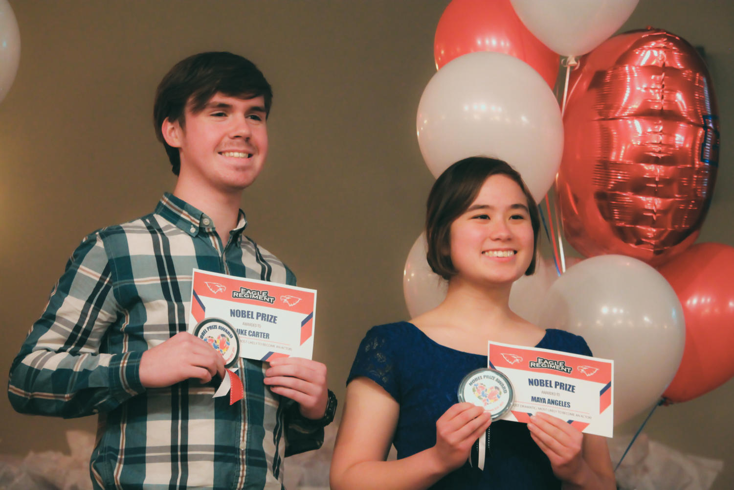 Seniors Luke Carter and Maya Angeles smile with their awards.