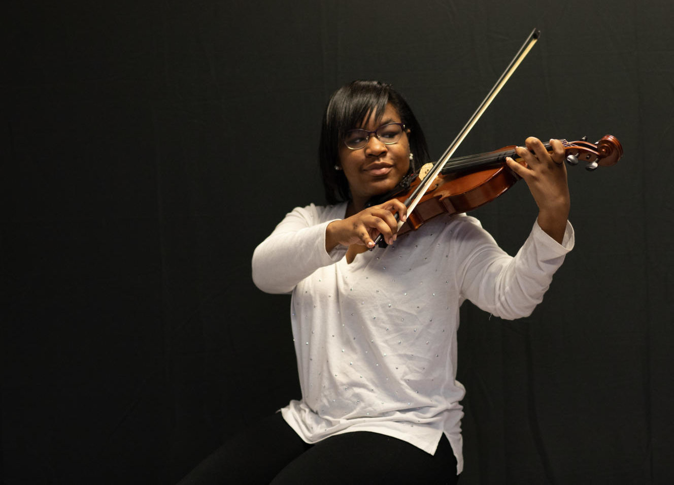 Aria Ellis has been playing viola for 8 years now and does not plan on stopping.