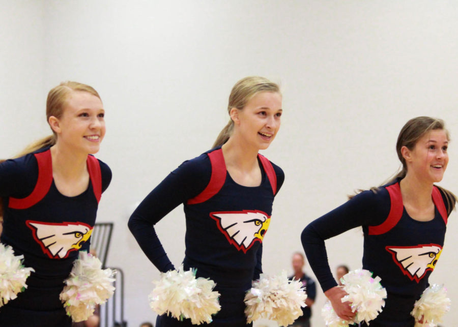 Hailey Forck, Bella Bahr and Kylie Bernet dances at the first day of school assembly.