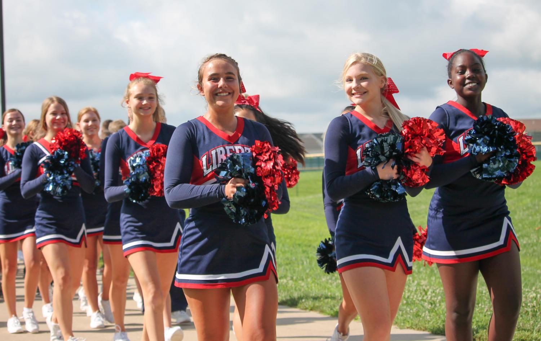 Freshmen+cheerleaders+lead+the+way+for+the+freshman+class+in+the+annual+bridgewalk.+