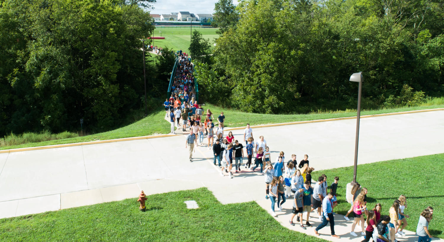 Freshmen+walk+into+a+new+chapter+of+their+lives+as+they+complete+the+bridgewalk+on+the+first+day+of+their+high+school+experience+Aug.+13.+
