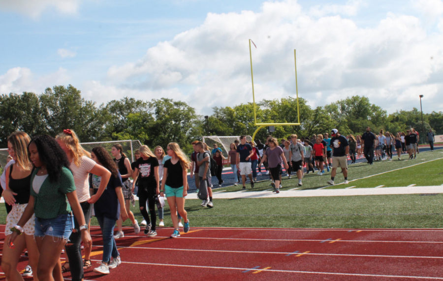 The freshmen class makes their way towards the bridge for their official introduction to high school.