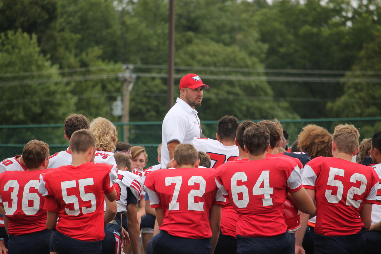 Coach+McMillen+talks+with+his+players+at+the+fall+kickoff.+