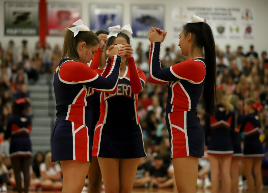 Cheerleaders prepare for their routine during their performance at the first day assembly.