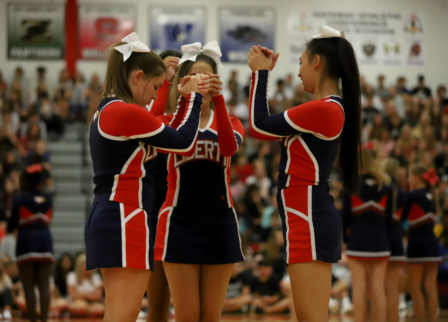 Cheerleaders+prepare+for+their+routine+during+their+performance+at+the+first+day+assembly.+