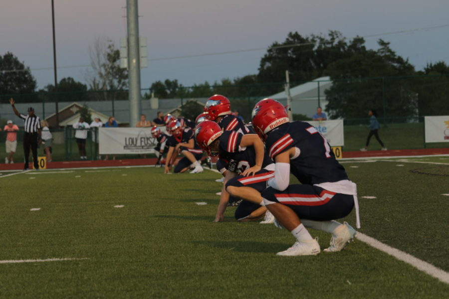 Varsity football warms up against Westminster.