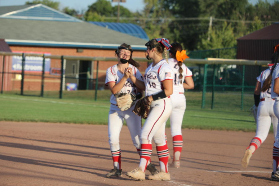 Seniors Kenzie Bensinger and Katie Reichle celebrate during the Eagles 8-7 win against Fort Zumwalt South on Sept. 26.