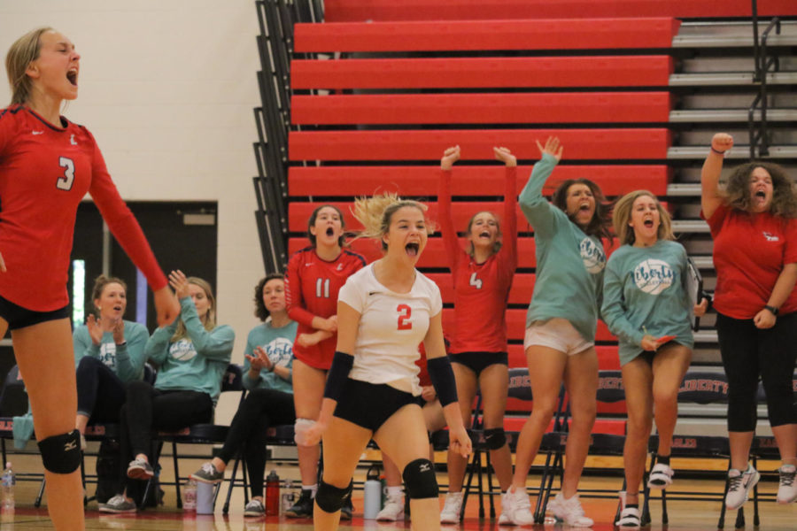 Hailey Buckley celebrates after JV volleyball scored a point in a match against