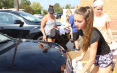 Freshman Francesca Aquino and other driver's ed. students take their time while washing their teachers' cars on Sept. 20.