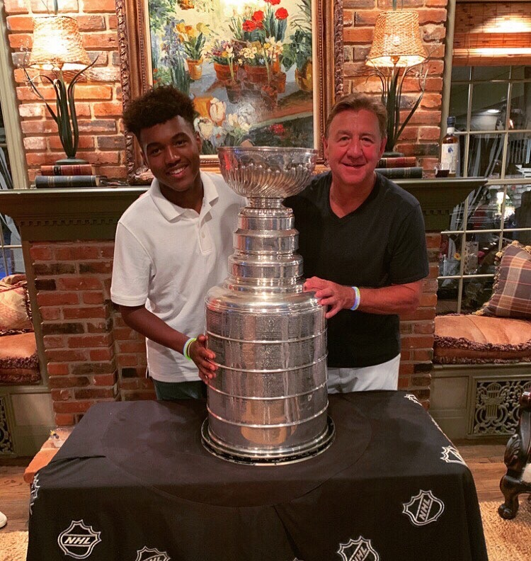 Maliek+Merrifield+%2811%29+poses+with+Blues+Hall+of+Famer+Bernie+Federko+and+the+Stanley+Cup.+