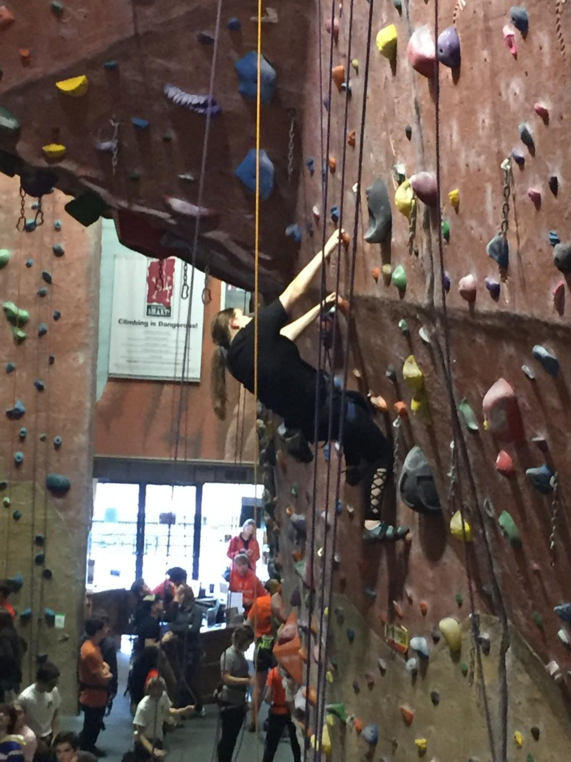 Cassie Tarrant is focused on completing a top-rope route for a school competition at the Upper Limits Rock Climbing Gym in downtown St. Louis.