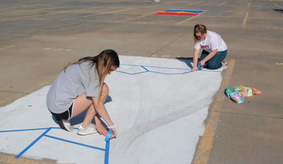 Sarah Rowley and her friend design her parking spot.
