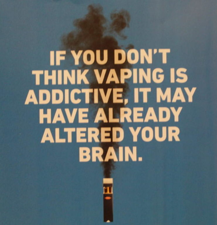 A poster describes one of the effects of vaping.