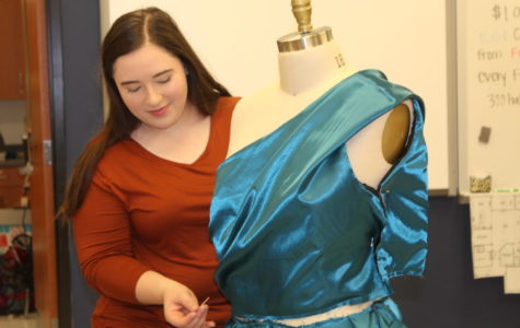 Senior Katelyn Yoder perfects her hand-made dress during class time.