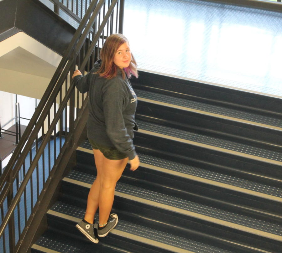 Zoe Carpenter goes up the stairs like she is going up in life.