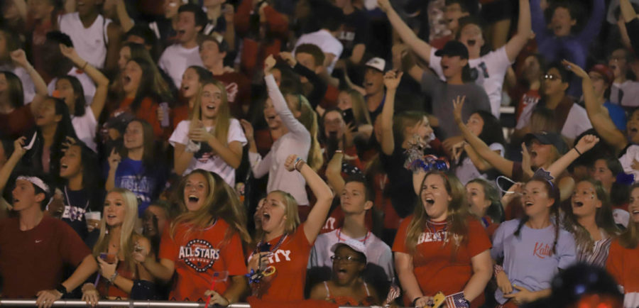 A+loud+student+crowd+cheers+the+varsity+football+team+on+in+their+exciting+overtime+victory+over+Westminster.