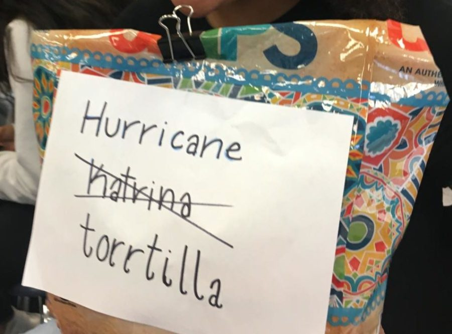 "Grayce Page brings a bag of tortilla chips with a sign that refers to the vine that goes,""hurricane Katrina? More like hurricane Tortilla."