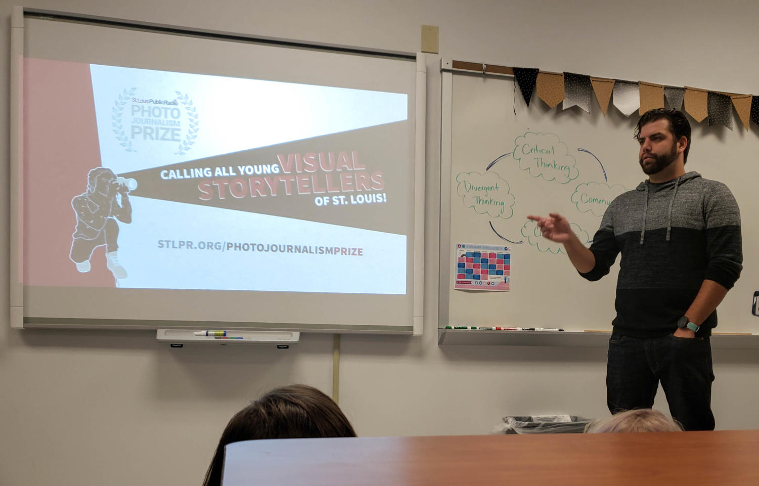 David Kovaluk explains what the photojournalism contest is after giving his presentation to the first hour graphic design, journalism and photography classes.