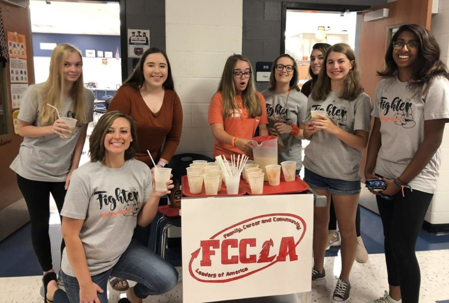 FCCLA+members+Audrey+Champers+%28left%29+and+Katelyn+Yoder+%28middle%29+setting+up+the+coffee+stand