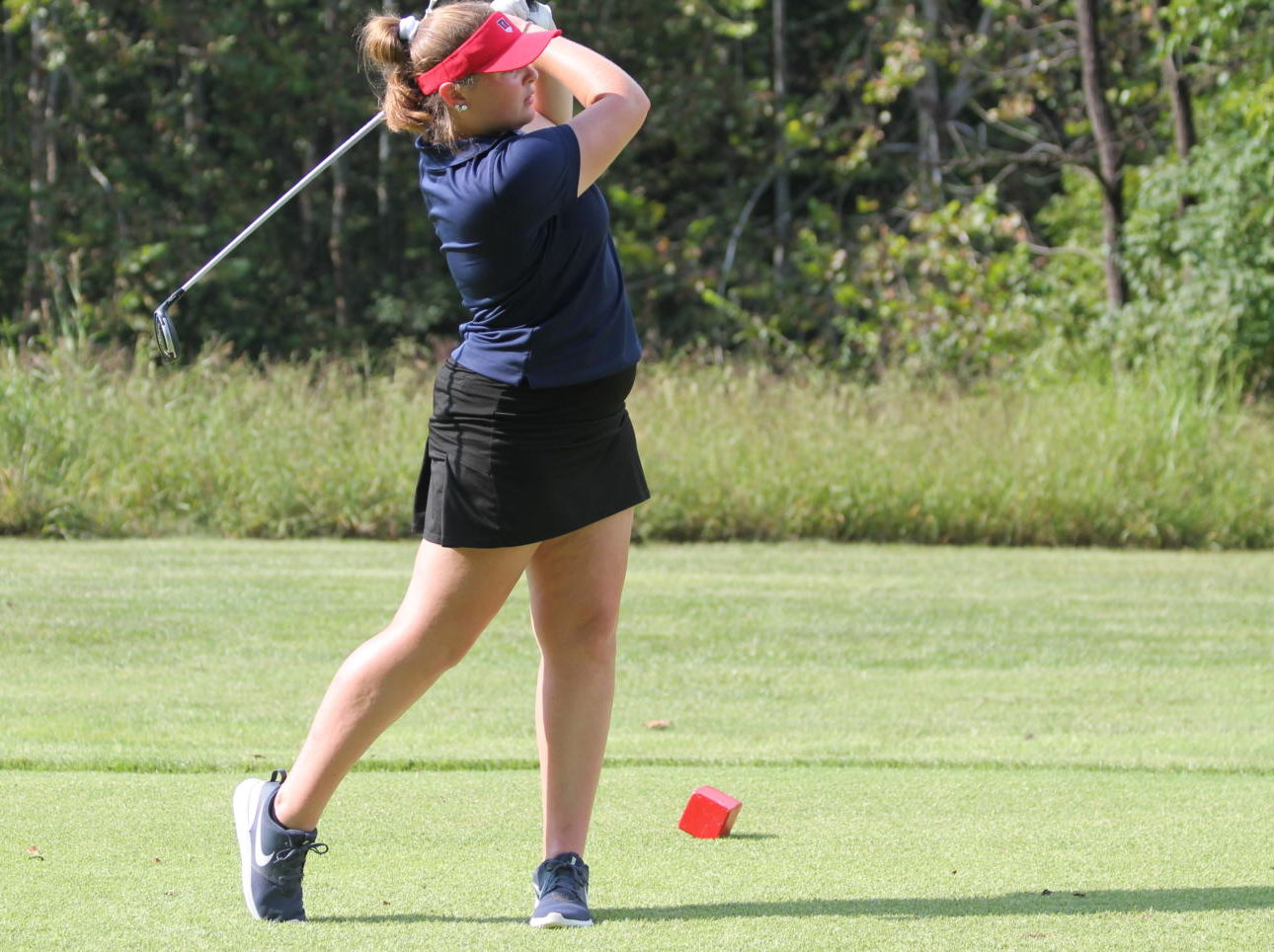 Madeline Francis tees off at her during a match.