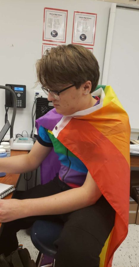Senior Drew Goodman wears full pride flag to celebrate National Coming Out Day.